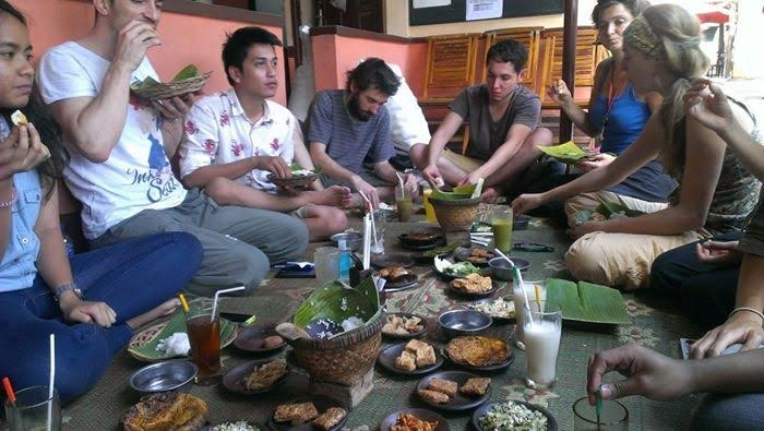 Indonesian people eating using right hand
