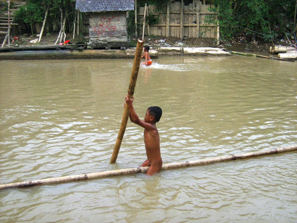 A Dayak boy practicing early lessons of life