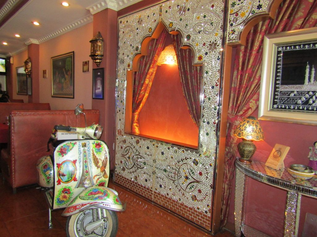 A funky corner inside Koh-e-noor Restaurant, with the unique painted Vespa