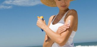 Best-Skin-Sun-Protection-for-Summer-2018-Women-applying-Sunblock