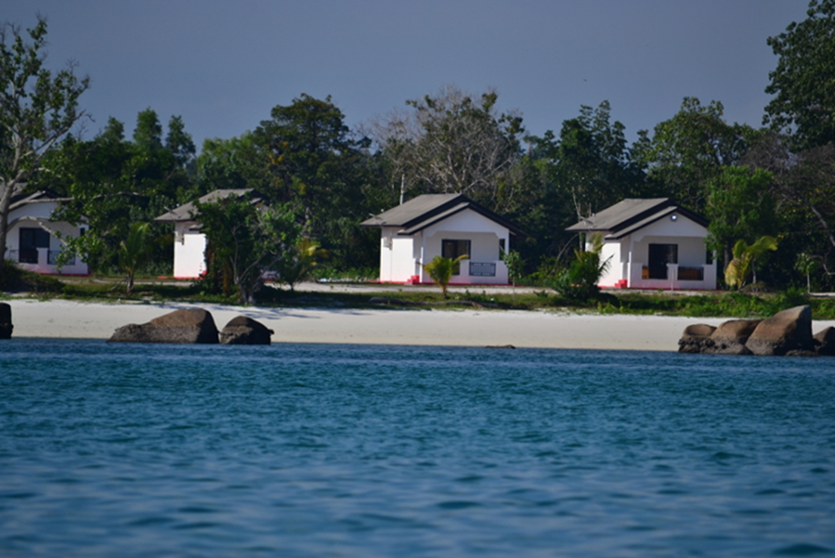 Lovely cottages on the beaches carpeted with bleached white sands