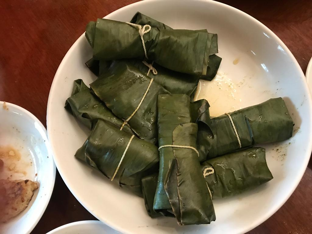 Steamed Patra ni Macchi in banana leaf parcels