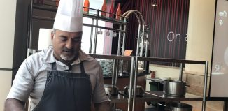 Pradeep Sainani demonstrating his dishes