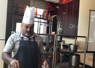Pradeep Sainani demonstrating his dishes