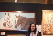 Arupa with her Artworks at Exhibition