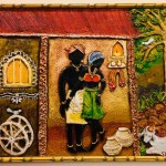 Mural with clay-village couple by Shanthi Seshadri